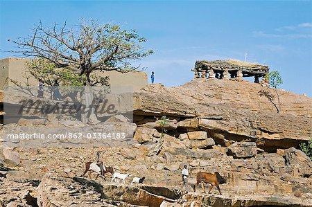 Mali,Dogon Country. A scene near Sangha,an attractive Dogon village built among rocks on top of the Bandiagara escarpment. The men's meeting house,or Toguna,is on the skyline.