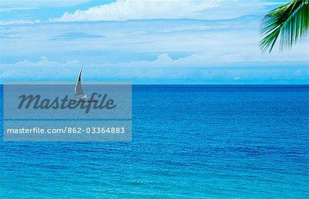A fishing dhow sails past Benguerra Island.
