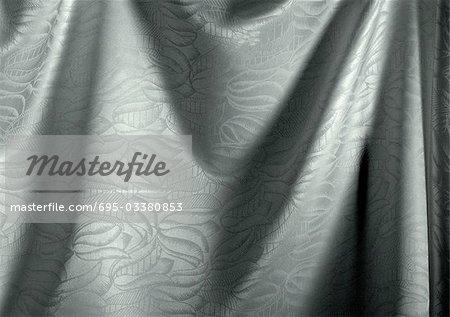 Falten in Silber Stoff mit floralem Muster, Nahaufnahme, full-frame