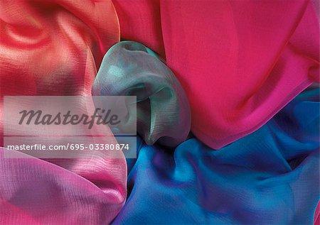 Multicolored fabrics, close-up, full frame