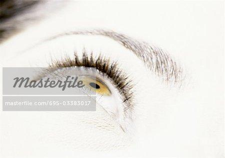 Woman's hazel eye looking up, close up.