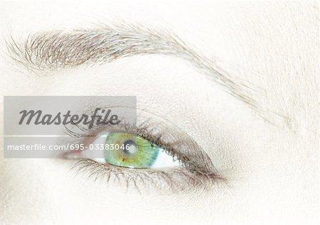 Woman's green eye, close-up