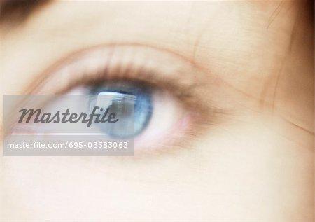Woman's blue eye, blurred close up.