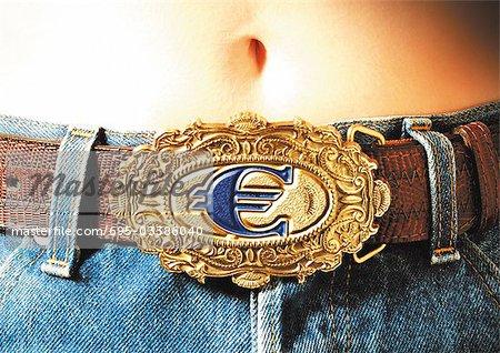 Euro sign belt buckle.