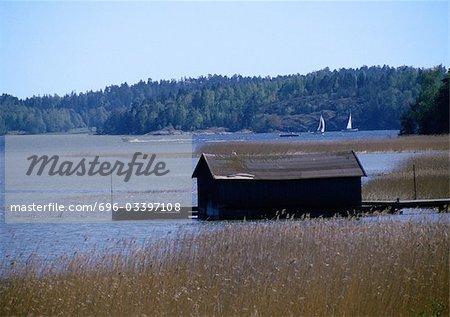 Scandinavia, boathouse next to lake