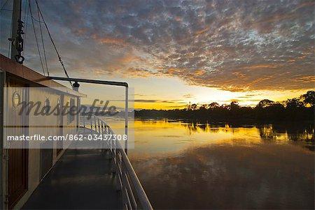 Peru,Amazon River. Sunrise on the Ayapua Riverboat,Yavari River,a tributary of the Amazon River.