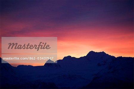 USA,Alaska. Sunrise over the Kenai Mountains as viewed from mile 14.5 East Road near Homer.