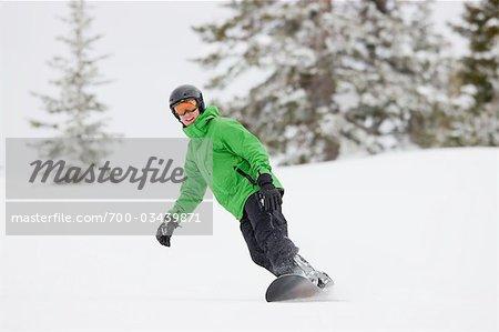 Man Snowboarding near Steamboat Springs, Colorado, USA