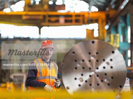 Engineer Working With Steel Part