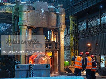 Engineers & Hot Steel In Forging Machine