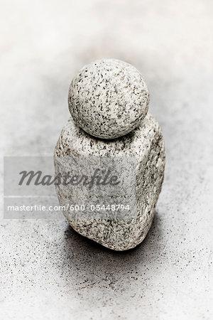 Round Rock Balancing on Square Rock