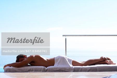 Landscape handsome man on massage table