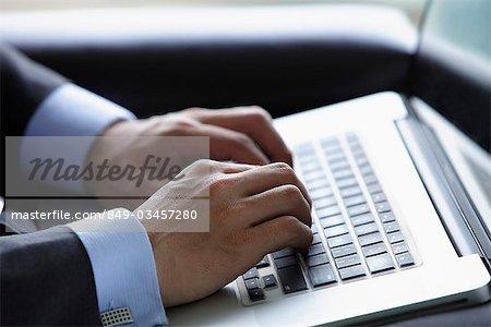 Close up of man using lap top computer