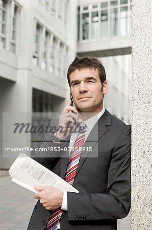 Businessman using mobile phone, waist up