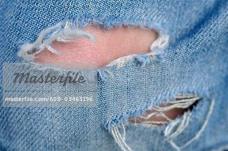 Tear in Blue Jeans