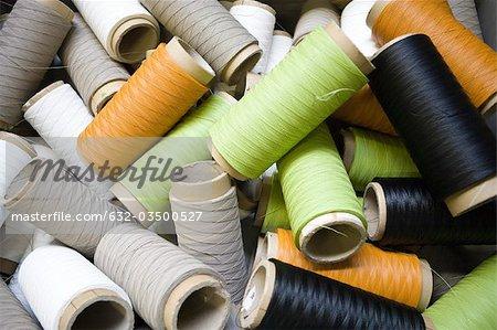 Département de fabrication textile composite recyclable d'usine, bobines de fil enduit excès
