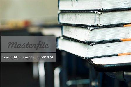Stack of textbooks on school desk