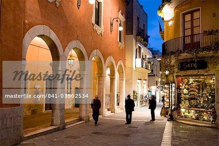 Locals in street at night, Taormina, Sicily, Italy, Europe