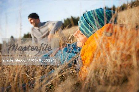 Couple Sitting in Long Grass near Deschutes River, Oregon, USA