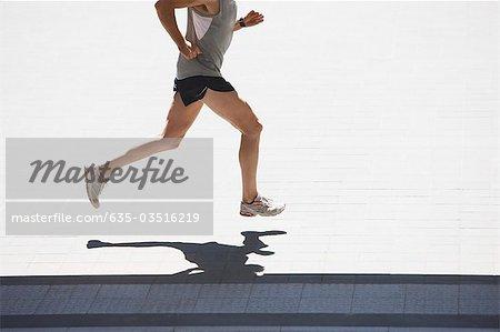 Man running on urban sidewalk