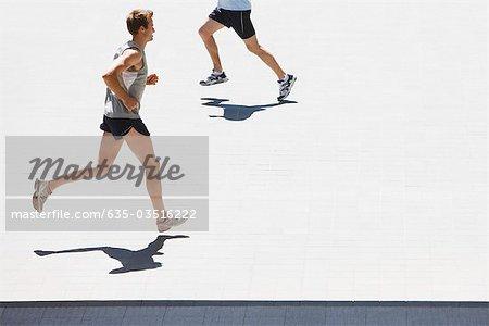 Men running in urban setting