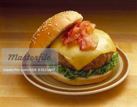Bacon Cheeseburger on Sesame Seed Bun; On Plate