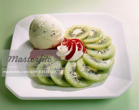 Kiwi ice cream, kiwi fruit slices, cream, strawberry sauce