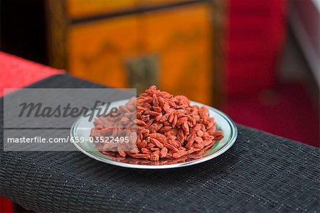Dried goji berries on a plate