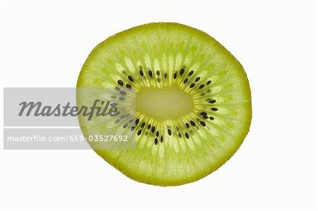 A slice of kiwi fruit (backlit)