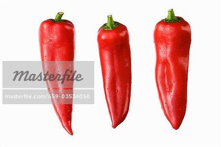 Drei rote Paprika Spitz
