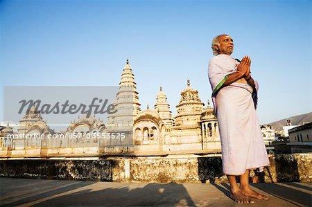 Man praying in a temple, Pushkar, Ajmer, Rajasthan, India