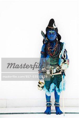 Boy dressed as Hindu god Shiva
