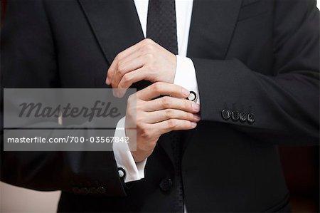Close-up of Groom Adjusting Cuff Links