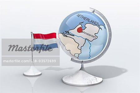 Globe montre pays-bas agrandi avec drapeau