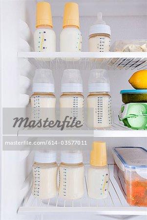 Bottles of breast milk in refrigerator