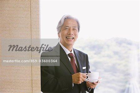 Executive Businessman Drinking Coffee