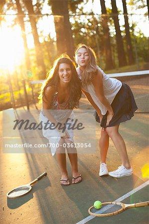 Two Young Women Tennis Court