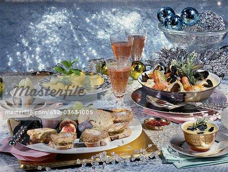 Foie gras terrine,shellfish soup with truffles and pineapple carpaccio