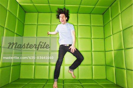 Man dancing in padded room