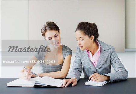 Businesswoman reading book