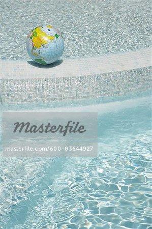 Beach Ball Globe in Swimming Pool, Sanary-sur-Mer, Var, Provence, Provence-Alpes-Cote d'Azur, France