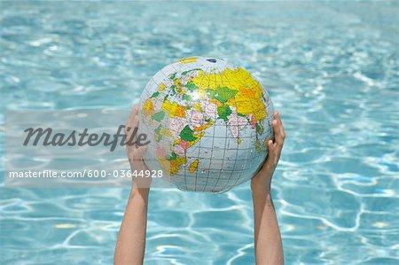 Woman Holding Inflatable Globe, Sanary-sur-Mer, Var, Provence, Provence-Alpes-Cote d'Azur, France