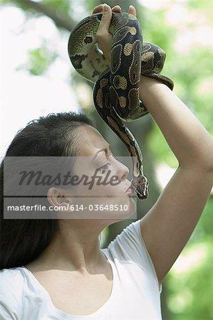 Woman kissing a snake