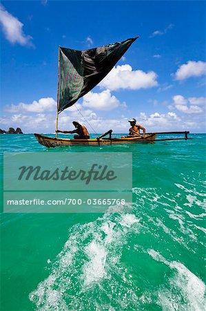 Men in Outrigger Canoe, Nihiwatu Resort, Sumba, Lesser Sunda Islands, Indonesia