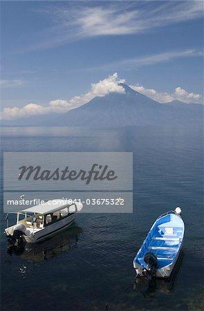 Tour boats anchored near Panajachel, San Pedro Volcano in the background, Lake Atitlan, Guatemala, Central America