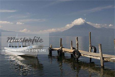 Tour boat near Panajachel, San Pedro Volcano in the background, Lake Atitlan, Guatemala, Central America
