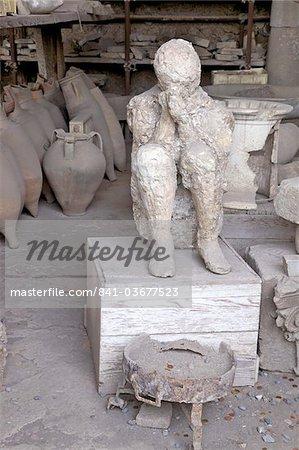 Horrea or Granai del Foro housing archaeological relics including plaster cast of victim of Vesuvius eruption, Pompeii, Campania, Italy, Europe