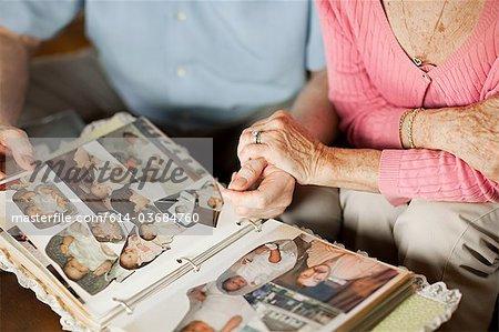 Senior couple with at family album