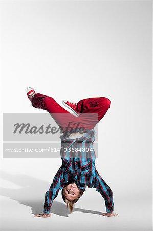 Teenage boy doing a handstand