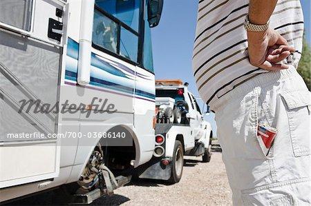 Man Watching RV being Towed in Desert, near Yuma, Arizona, USA